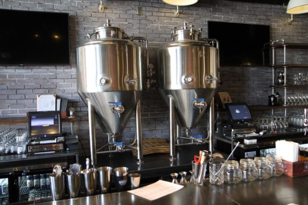 Two large fermenters in the bar area