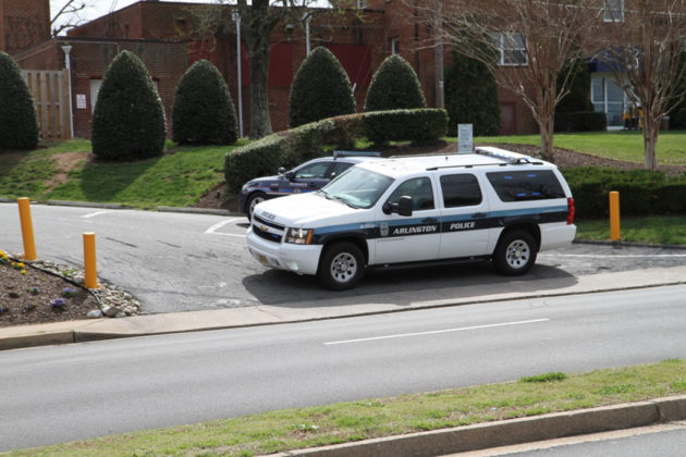 Police blocked the entrance to the Patrick Henry apartments