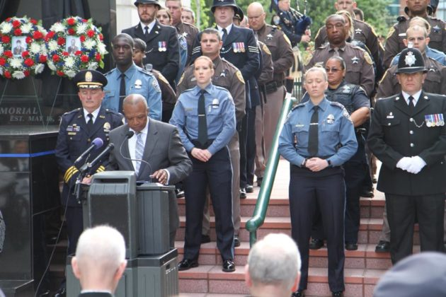 Auxiliary Sergeant Charles Neal reads the roll call of fallen officers