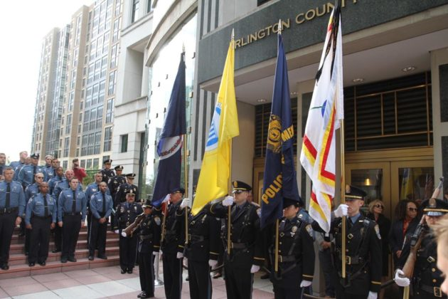 The police's color guard stands to attention