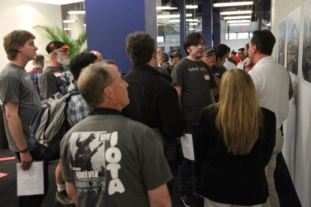 Devin Corini (in white) of Regency Centers discusses the plan with attendees