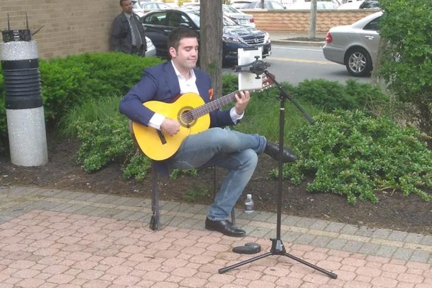 Outside, a guitarist played just yards away from Clarendon Blvd