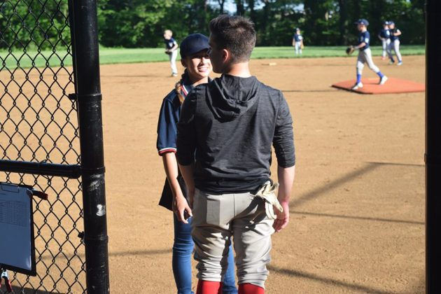 Graham said she was introduced to umpiring by her classmate Nicolas Lopez-Riveira (right)