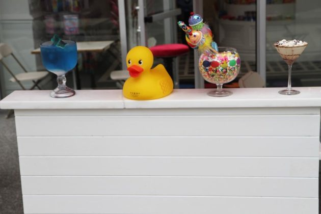 Items on the outdoor host stand at Sugar Factory