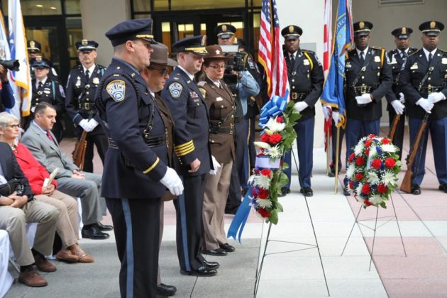Arlington law enforcement leaders lay a wreath honoring those who died in the line of duty