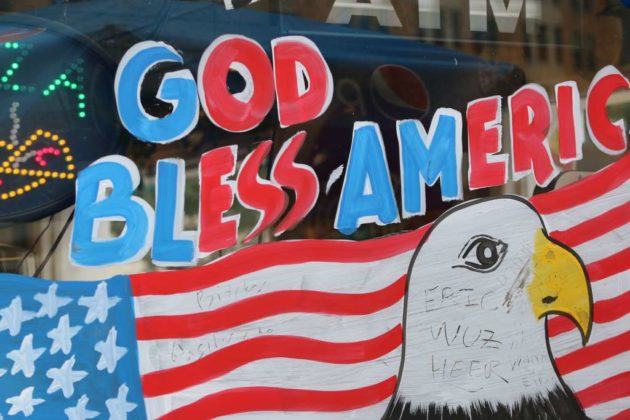 """God Bless America"" sign in the window of Goody's in Clarendon"