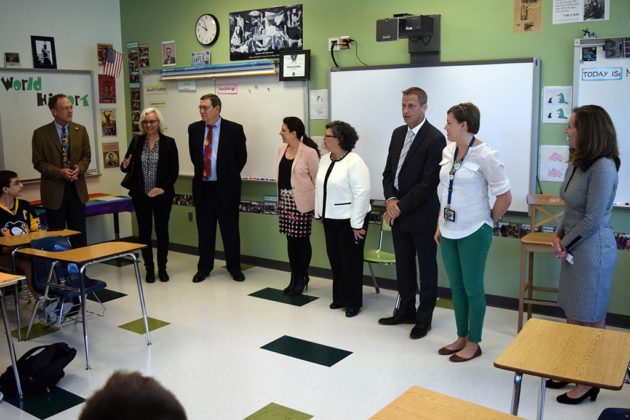 Various school officials and School Board members joined the announcement