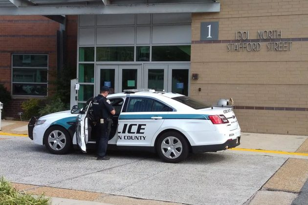 Police outside of Washington-Lee High school during threat investigation