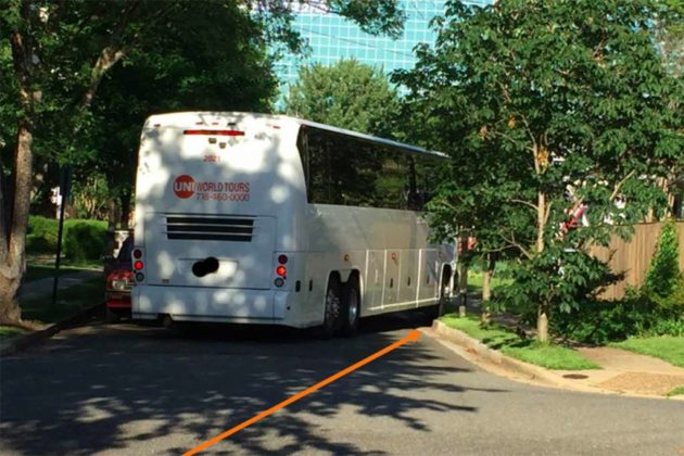 """A bus on a sidewalk, because streets are too narrow for turns"""