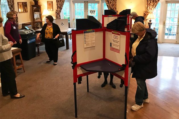 Voting in a polling station in Fairlington on Nov. 7, 2017