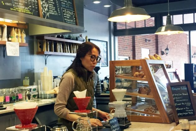 Sense of Place cafe interior with barista Kay