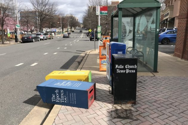 Newspaper boxes knocked over by heavy wind in Clarendon