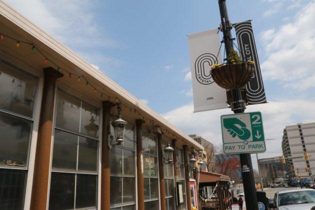 Cafe Italia exterior next to Crystal City signage