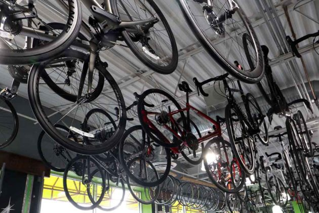 Bikes hang from the ceiling of Spokes Etc.'s new Ballston location.