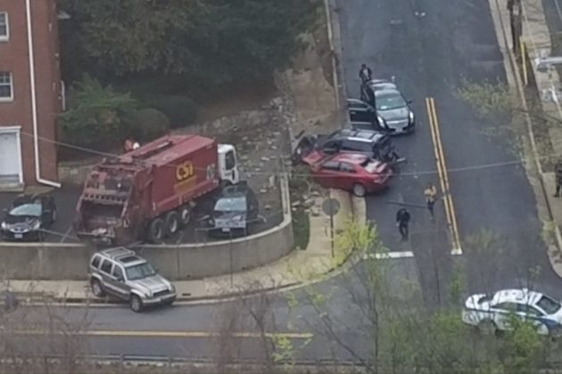 Trash truck smashes into cars in parking lot near Rosslyn (photo courtesy @idlelupino)