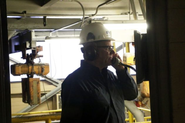 Facility Manager Bryan Donnelly on the phone in a metals recovery area