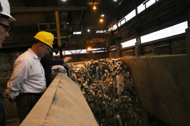Covanta's business manager, Don Cammarata, views the trash pit