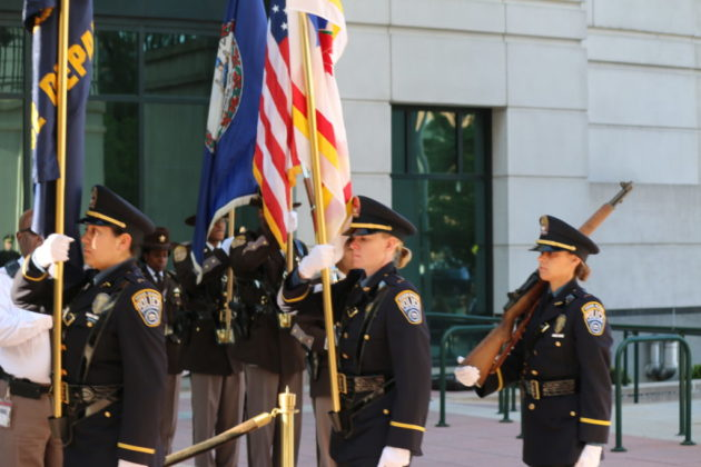 Arlington County Police officers present the colors.