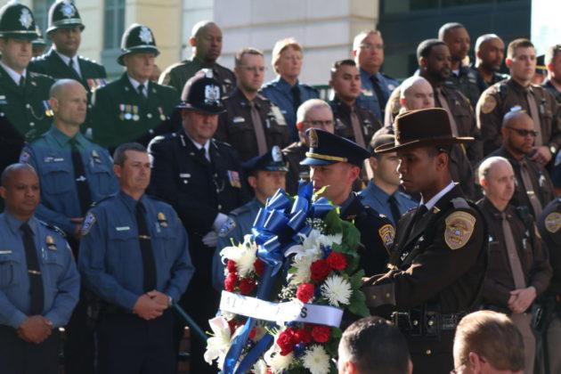 An Arlington Police officer and sheriff's deputy lay a wreath.