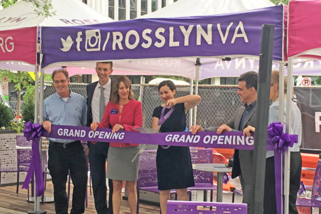 "County Board Chair Katie Cristol cuts the ribbon on Rosslyn's ""parklet"" (photo by Alex Koma)"