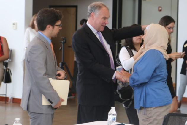 Sen. Tim Kaine greets Priscilla Martinez at an immigration forum.