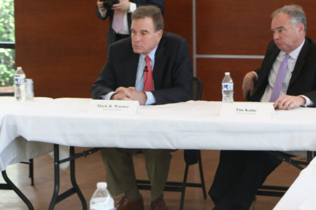 Sens. Mark Warner (left) and Tim Kaine at an immigration forum.