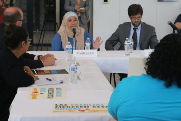Priscilla Martinez with the ADAMS Center address an immigration roundtable.