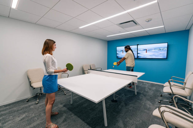 An office conference table can be converted for ping pong games (photo courtesy Axios)